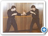 Quote: Here's Carl and I in our first self-defense school in Linden, NJ circa 1979. Notice the early defiance of traditional arts by wearing black GI, T-shirts, and wrestling shoes. The name of our school was Personal Survival Tactics (Carl's idea).